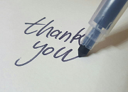 A pen writing out thank you